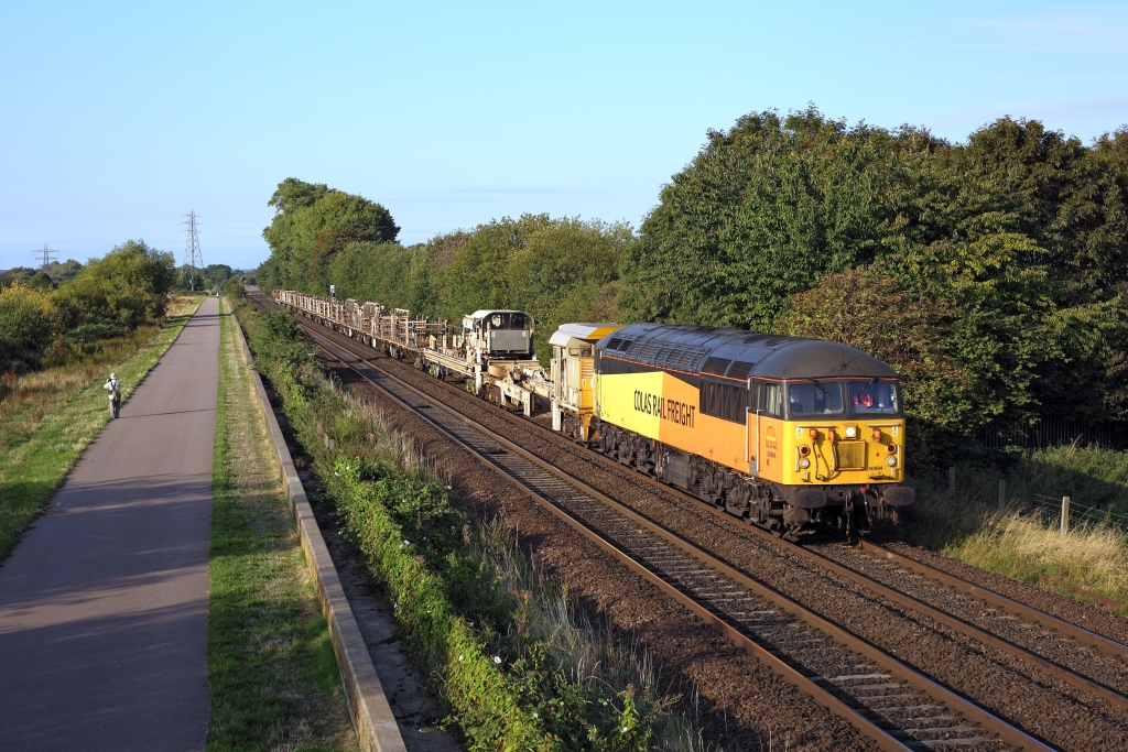 56094 hurries past Attenborough Nature Reserve on 2nd September 2018, working the 6C77 0655 Syston South Junction - Doncaster Belmont Down Yard with an empty rail discharge set in the consist. Photo copyright: Ben Wheeler.