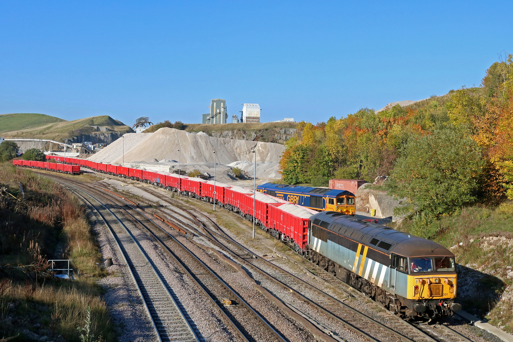 56301 shunting a rake of DB red liveried MRA box wagons at Peak Forest on 10th October 2018. Photo copyright: Paul Biggs.